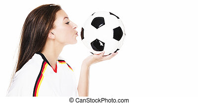 beautiful young woman kissing a football on white background