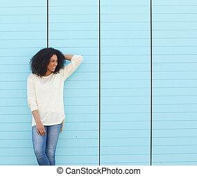 Beautiful young woman laughing outdoors