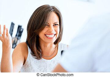 Beautiful young woman laughing portrait