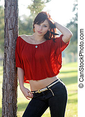 Beautiful Young Woman Leaning on a Tree (1)