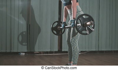 beautiful young woman lifting weights