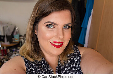 Beautiful young woman looking at camera and smiling