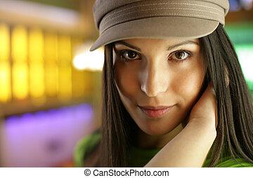 Beautiful young woman looking at camera, close-up