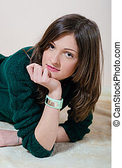 beautiful young woman looking at camera in knitwear