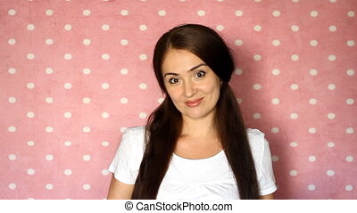 Beautiful young woman looking at camera and smiling.