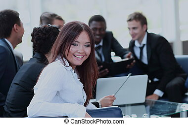Beautiful young woman looking at camera with smile at the modern