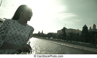 Beautiful young woman looking at Moscow Kremlin. Travel to...