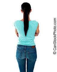 Beautiful young woman looking at wall. Rear view