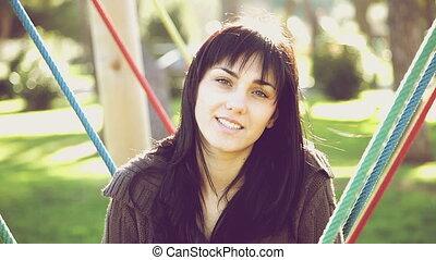Beautiful young woman looking camer