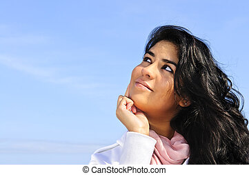 Beautiful young woman looking up