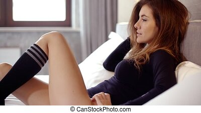 Beautiful Young Woman Lying on Her Bed