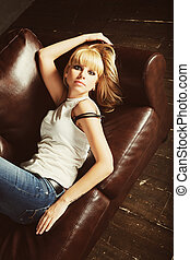 beautiful young woman lying on sofa