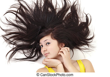 beautiful young woman lying on white with scatter hair