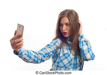 Beautiful young woman making selfie photo