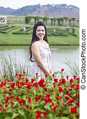 Beautiful Young Woman Meadow of Flowers. Enjoy Nature