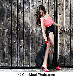 Beautiful young woman, model of fashion, with very long legs