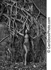 Beautiful young Woman near Banyan Tree in the rainforest in ...