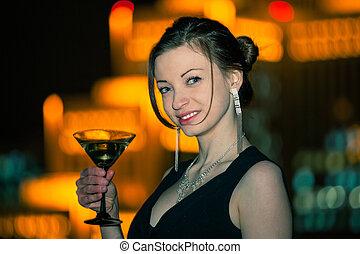 Beautiful young woman night city