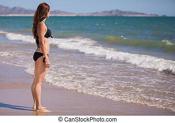 Beautiful young woman on a bikini