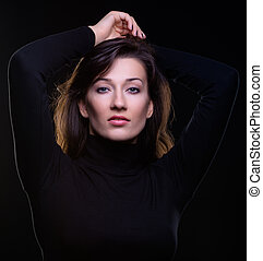 beautiful young woman on a black background