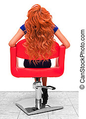 Beautiful young woman on a chair