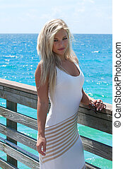 Beautiful young woman on a pier in south Florida