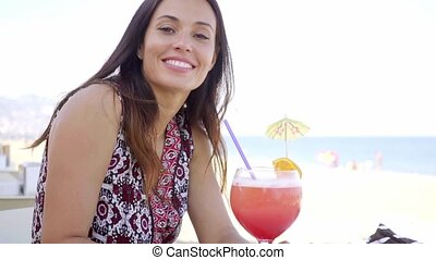 Beautiful young woman on a summer vacation