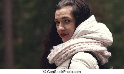 Beautiful young woman on a walk in the autumn park