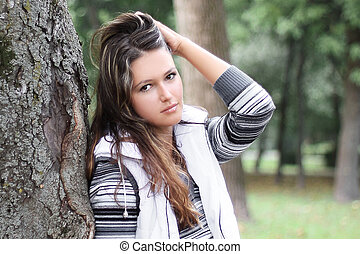 beautiful young woman on background of city Park