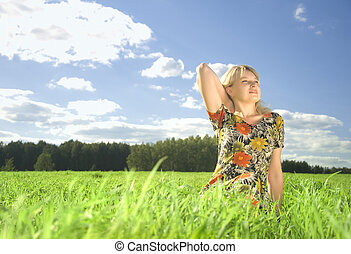 beautiful young woman on field in summer time
