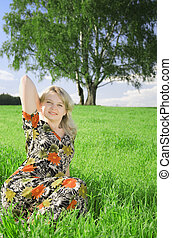 beautiful young woman on field
