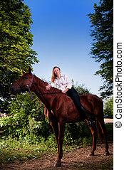 beautiful young woman on horseback