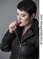 Beautiful young woman on leather jacket