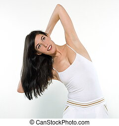 beautiful young woman on studio isolated white background doing her workout stretch