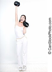 beautiful young woman on studio isolated white background doing her workout welghtlifting dumbbel