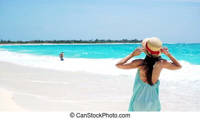 Beautiful vacation woman in sun smiling happy on summer holidays on white beach.