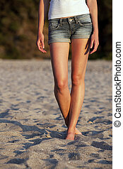 beautiful young woman on the beach - lower body