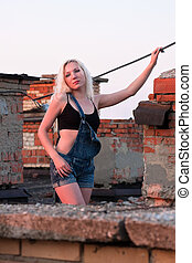 Beautiful young woman on the roof