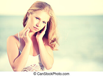beautiful young woman on the sea, ocean