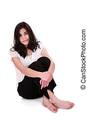 Beautiful young woman or teen relaxing on floor