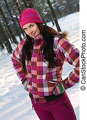 Beautiful young woman outdoor in winter