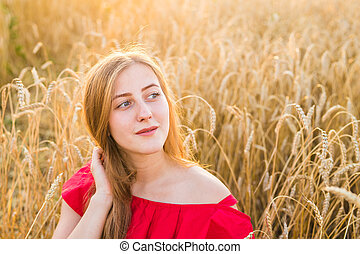 Beautiful Young Woman Outdoors. Enjoy Nature. Girl in the field