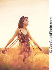 Romantic Model in Sun Dress in Golden Field at Sunset - ...