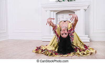 beautiful young woman performing passionate Gypsy dance