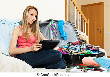 woman planning a vacation and journey on a tablet