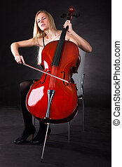 Beautiful young woman playing cello