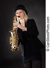 Beautiful young woman playing saxophone