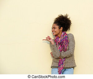 Beautiful young woman pointing finger