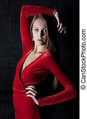 Beautiful young woman portrait in red dress