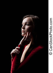 Beautiful young woman portrait in red cloth